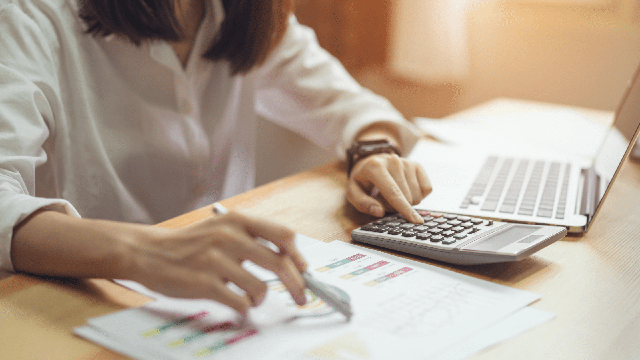 payroll-services-page-banner-woman-calculating-payroll-